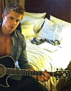 Alexander Ludwig playing guitar