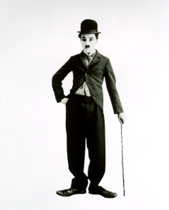 This is Charlie Chaplin in costume as his signature character The Tramp
